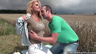 Sexy senior lady with big tits gets fucked outdoors