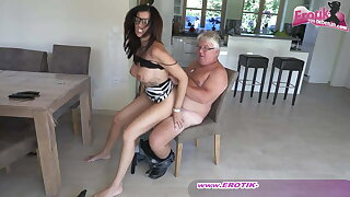 Sexy and busty German milf secretary with glasses and an ugly guy